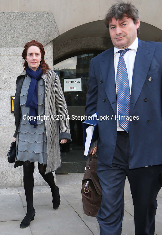 Rebekah and Charlie Brooks leaving the phone hacking trial at the Old Bailey in London, Friday, 21st February 2014. Picture by Stephen Lock / i-Images