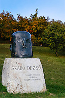 Budapest, Hungary. Gellert Hill. Bust of Szabó Dezs? and the Statue of the Liberty in the background.
