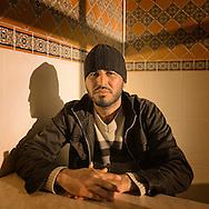 TUNISIA,Sbeitla:Houssine, a resident of Sbeitla poses for a portrait. Copyright Christian Minelli.