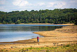 © Licensed to London News Pictures. 19/07/2018. Harrogate UK. The water level at Swinsty Reservoir near Harrogate in Yorkshire has dropped significantly since the UK heatwave started almost a month ago. Photo credit: Andrew McCaren/LNP