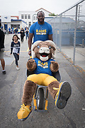 Los Angeles Rams mascot Rampage rides in a wheelbarrow during community improvement project at Belvedere Elementary School to upgrade play and social spaces around the school by building a new playground structure, painting murals and basketball backboards and landscaping., Friday, June 14, 2019, in Los Angeles, Calif. (Ed Ruvalcaba/Image of Sport)