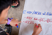 Ethnic Shan youths write a chart to present material learned at a two-day training on HIV/AIDS prevention run by Shan Youth Power (SYP) at Ban Wiang Wai, Chiang Mai, Thailand on July 16, 2011.