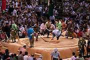 Assistants cleaning the ring after a bout in the controversial Nagoya summer Grand Sumo Tournament held on the 14th and second final day.