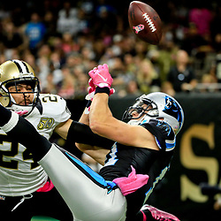 Oct 16, 2016; New Orleans, LA, USA; New Orleans Saints cornerback Sterling Moore (24) is called for pass interference on Carolina Panthers wide receiver Devin Funchess (17) during the second half of a game at the Mercedes-Benz Superdome. The Saints defeated the Panthers 41-38. Mandatory Credit: Derick E. Hingle-USA TODAY Sports