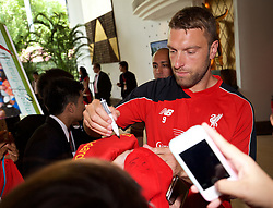 BANGKOK, THAILAND - Monday, July 13, 2015: Liverpool's Rickie Lambert signs autographs for supporters at the Plaza Athenee team hotel in Bangkok on day one of the club's preseason tour. (Pic by David Rawcliffe/Propaganda)