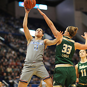 HARTFORD, CONNECTICUT- JANUARY 10: Kia Nurse #11 of the Connecticut Huskies drives to the basket defended by Kitija Laksa #33 of the South Florida Bulls during the the UConn Huskies Vs USF Bulls, NCAA Women's Basketball game on January 10th, 2017 at the XL Center, Hartford, Connecticut. (Photo by Tim Clayton/Corbis via Getty Images)