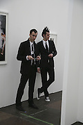 Owen Clements and Scott Penkava, The Professional View and Private View of Frieze Art Fair. London. 11 october 2006. -DO NOT ARCHIVE-© Copyright Photograph by Dafydd Jones 66 Stockwell Park Rd. London SW9 0DA Tel 020 7733 0108 www.dafjones.com