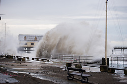 © Licensed to London News Pictures. 04/01/2014. Aberystwyth, UK At high tide on Saturday 4 Jan 2014, more huge waves batter the seaside  and promenade at Aberystwyth. Photo credit : Keith Morris/LNP