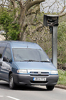 Van driving past vandalised Gatso speed camera damaged by fire ....