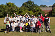 Old Bethpage, New York, U.S. 29th September 2013.  Referee GARY MONTI, of Westbury, back row far left, poses with the teams and their children after the Old Time Base Ball championship game, where Brooklyn Eckfords beat Brooklyn Excelsiors, at The Long Island Fair. A yearly event since 1842, the county fair is now held at a reconstructed fairground at Old Bethpage Village Restoration.