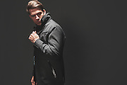 BIRMINGHAM, AL – DECEMBER 19, 2014: A caucasian male modeling fashionable men's outerwear.