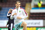 James Tarkowski of Burnley warming up before the Sky Bet Championship match between Burnley and Cardiff City at Turf Moor, Burnley, England on 5 April 2016. Photo by Simon Brady.