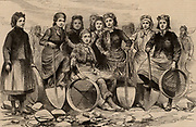 A Lancashire colliery pit-brow women.  In 1887 some of these women travelled to London to lobby the Home Secretary to resist the proposed clause in the Mines Regulation Bill which would prevent them doing this traditional work which was, by many, thought unsuitable for women.  From 'The Illustrated London News' (London, 28 May 1887). Engraving.