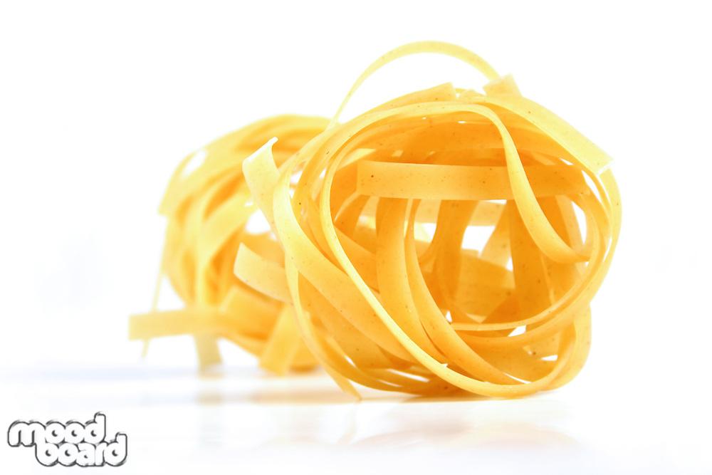 Tagliatelle pasta on white background