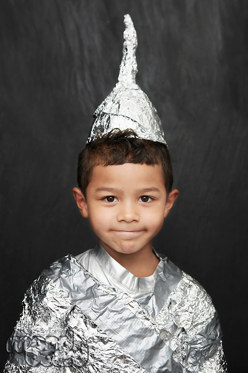 Portrait of young boy (5-6) in aluminum foil knight costume studio shot