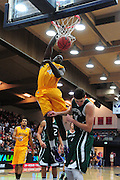November 27, 2011; Moraga, CA, USA; San Francisco State Gators forward James Albright (top) dunks the ball during the first half of the Shamrock Office Solutions Classic against the Saint Mary's Gaels at McKeon Pavilion. The Gaels defeated the Gators 86-52.