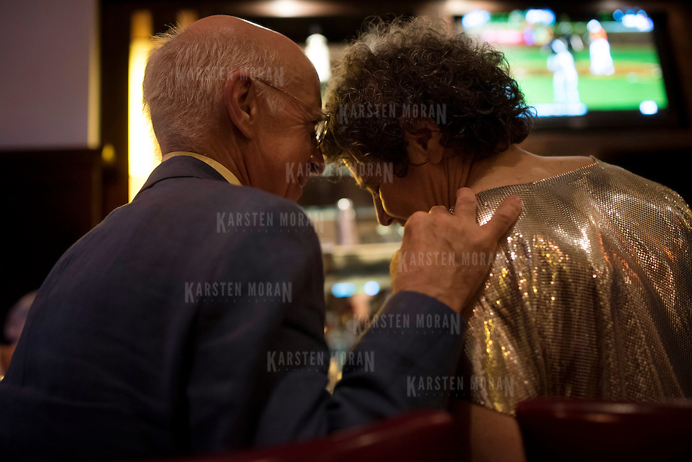 June 13, 2015 - New York, NY : Regulars Dick Fulmer, left, and Shelly Goldklank share a moment at the bar on Saturday night. After more than a decade of service, Ouest, the Upper West Side restaurant and bar, served its last meal on Saturday night.  CREDIT: Karsten Moran for The New York Times