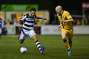 Forest Green Rovers Forward, Kaiyne Woolery (14) takes on Sutton United Midfielder, Nicky Bailey (16) during the Vanarama National League match between Sutton United and Forest Green Rovers at Gander Green Lane, Sutton, United Kingdom on 14 March 2017. Photo by Adam Rivers.