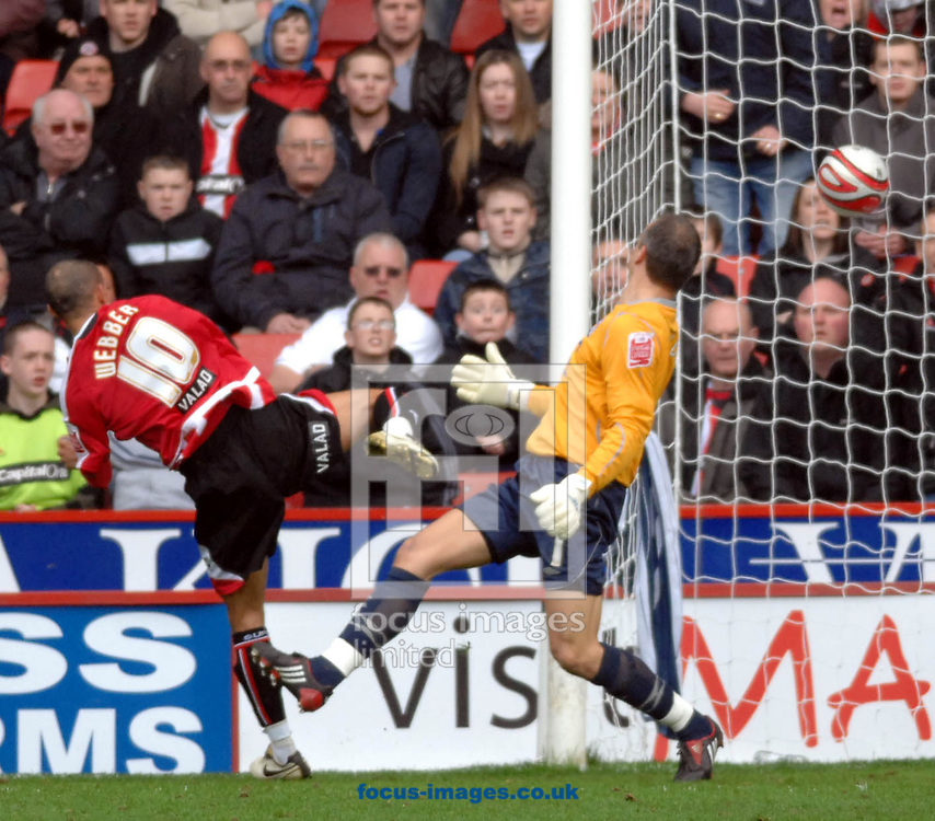 Sheffield - Sunday, March 1st, 2009:  Sheffield United's Danny Webberputs one past Birmingham City's Maik Taylor during the Coca Cola Championship match at Bramall Lane, Sheffield. (Pic by John Rushworth/Focus Images)