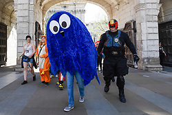 © Licensed to London News Pictures. 08/04/2017. London, UK. A Pac-Man ghost and Judge Dredd join participants taking part in the inaugural Games Character Parade, walking from Guildhall to Paternoster Square.  The event formed part of the London Games Festival welcoming cosplayers, wearing costumes inspired by videogame characters, to the UK's biggest parade of cosplayers.   Photo credit : Stephen Chung/LNP