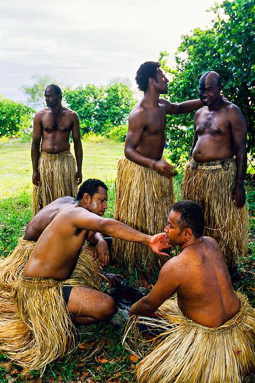 """Fijian Warriors"" preparing for a beach wedding ceremony, Vomo Island Resort, Fiji Islands"