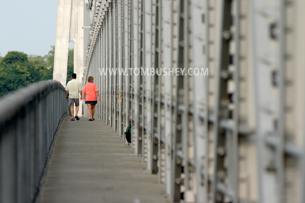 Highland, N.Y. - A couple walk across the Mid-Hudson Bridge between Highland and Poughkeepsie on July 8, 2006.
