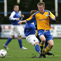 Queen of the South v St Johnstone...16.10.04<br />Mark Baxter tackled from behind<br /><br />Picture by Graeme Hart.<br />Copyright Perthshire Picture Agency<br />Tel: 01738 623350  Mobile: 07990 594431