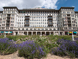 Large socialist era old apartment building on Karl Marx Allee in former East Berlin in Germany