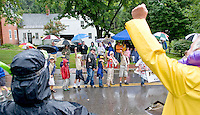 The rain did not dampen crowd or the spirit of Boy Scouts Pack Troup 243 as they performed for the judges during the Gilford Old Home Day parade on Saturday morning.  (Karen Bobotas/for the Laconia Daily Sun)
