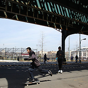 A skateboarder near Yankee Stadium on match day during the New York Yankees Vs Toronto Blue Jays season opening day at Yankee Stadium, The Bronx, New York. 6th April 2015. Photo Tim Clayton