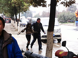 61139413<br /> Photo taken with a mobile phone on Feb. 27, 2014 shows an injured passenger (2nd R) escaping the bus fire site in Guiyang, capital of southwest China s Guizhou Province. A bus bursted into flames on Jinyang South Road in Guiyang on Thursday, leaving five people dead so far, Thursday, 27th February 2014. Picture by  imago / i-Images<br /> UK ONLY