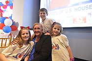 Garden City, New York, USA. November 6, 2018. Nassau County Democrats watch Election Day results at Garden City Hotel, Long Island.  Judicial candidate JOANNE CURRAN PERRUCCI is with her children, mother-in-law and husband.