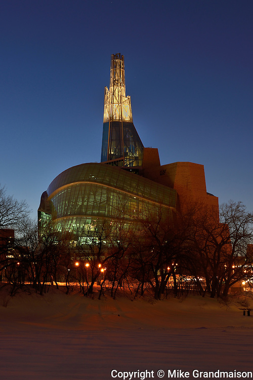 Canadian Museum for Human Rights (CMHR) in winter at dusk<br /> Winnipeg<br /> Manitoba<br /> Canada