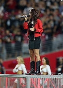 Singer songwriter Ashley Wineland sings the National Anthem before the Arizona Cardinals 2016 NFL preseason football game against the Oakland Raiders on Friday, Aug. 12, 2016 in Glendale, Ariz. The Raiders won the game 31-10. (©Paul Anthony Spinelli)