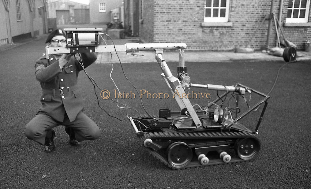 Bomb Disposal Robot.   (J97)..1975..29.12.1975..12.29.1975..29th December 1975..At Clancy Barracks,Dublin the Irish army put on display their newly aquired Bomb Disposal Robot. It would be invaluable in inspecting suspect buildings or vehicles. The series of pictures shows the army demonstration of the equipment..Picture shows an army sergeant preparing the vehicle for the demonstration at Clancy Barracks, Dublin.