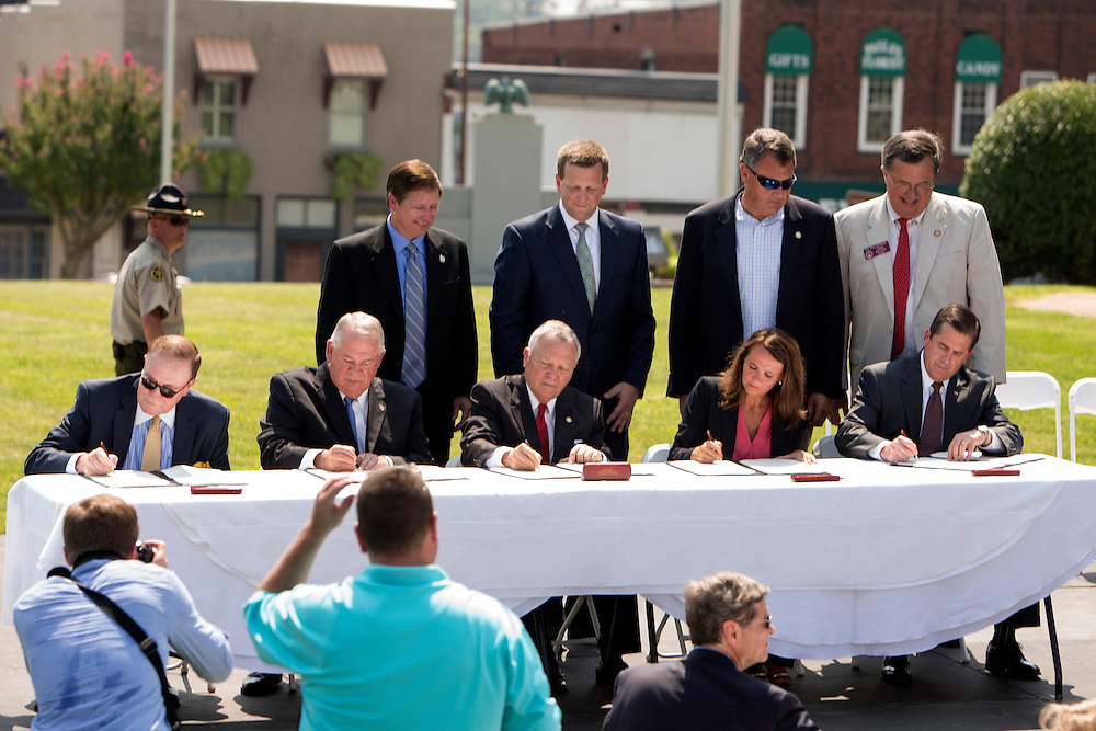 From left to right, CSX Senior Vice President Clarence Gooden, Georgia House Speaker David Ralston, Georgia Gov. Nathan Deal, Murray County Commissioner Brittany Pittman, and Georgia Ports Authority Executive Director Curtis Foltz, sign the Memorandum of Agreement to establish the Appalachian Regional Port near Chatsworth, Ga., Tuesday, July 28, 2015, in Chatsworth, Ga. The inland port, due to open in 2018, will serve as a direct link from the Port of Savannah to North Georgia, Alabama, Tennessee and parts of Kentucky. (GPA Photo/Stephen B. Morton)