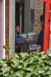 © Licensed to London News Pictures. 09/04/2013. London, UK Boxes are loaded into a shipping container from the North Korean Embassy in Ealing London today 9th April 2013. On Friday North Korea warned it would not be able to guarantee the safety of embassy staff in their country in the event of a war. Photo credit : Stephen Simpson/LNP