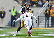 November 21, 2009: Iowa quarterback James Vandenberg (16) is sacked by Minnesota cornerback Ryan Collado (2) during the second half of the Iowa Hawkeyes 12-0 win over the Minnesota Golden Gophers at Kinnick Stadium in Iowa City, Iowa on November 21, 2009.