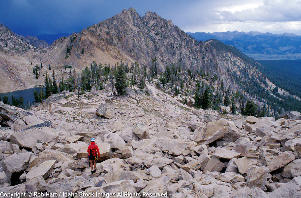 THIS PHOTO IS AVAILABLE FOR WEB DOWNLOAD ONLY. PLEASE CONTACT US FOR A LARGER PHOTO. Idaho. Sawtooth Mts. A climber descends from the Finger of Fate (9,760') during a rainstorm.