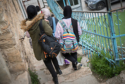 2 March 2020, Hebron: A group of girls walk towards a checkpoint in the H2 area of Hebron, which they have to pass on their way home after school.