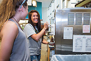 Shelby Henry, left, and Alyson Jones share a laugh over soft serve ice cream in Nelson Commons during Bobcat Student Orientation on Thursday, June 4, 2015.  Photo by Ohio University  /  Rob Hardin