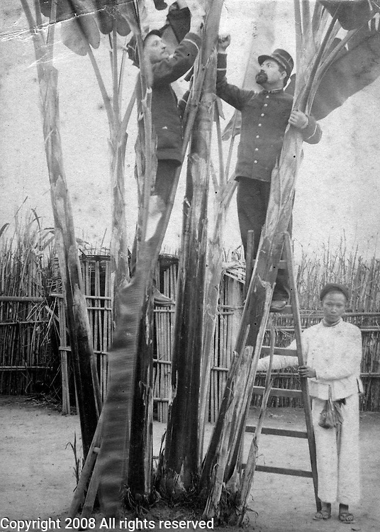Two French soldiers work with a Vietnamese native holding the ladder for them in Vietnam or Cambodia circa 1900. France moved into Vietnam in 1858, capturing Saigon in 1859. Using the south, then called Cochin China, as a base the French moved west and north completing the conquest of Indochina by 1907. (Indochina--the five territories under French authority: Cochin China, Annam, Tongking, Laos, and Cambodia.) The French also wanted to retain their colony after the Second World War. The Vietnamese rejected French rule, and after defeating the French at Dien Bien Phu, obtained their independence at the Geneva Conference in 1954. The United States sent military advisors starting in the late 1950s and became in embroiled in the Vietnam War which officially lasted from 1965 until 1975 leading to the deaths of over 58,000 American servicemen and women. .
