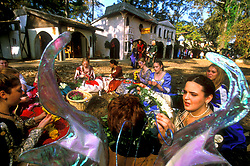 Stock photo of a group in costumes doing crafts at the Texas Renaissance Festival in Plantersville Texas