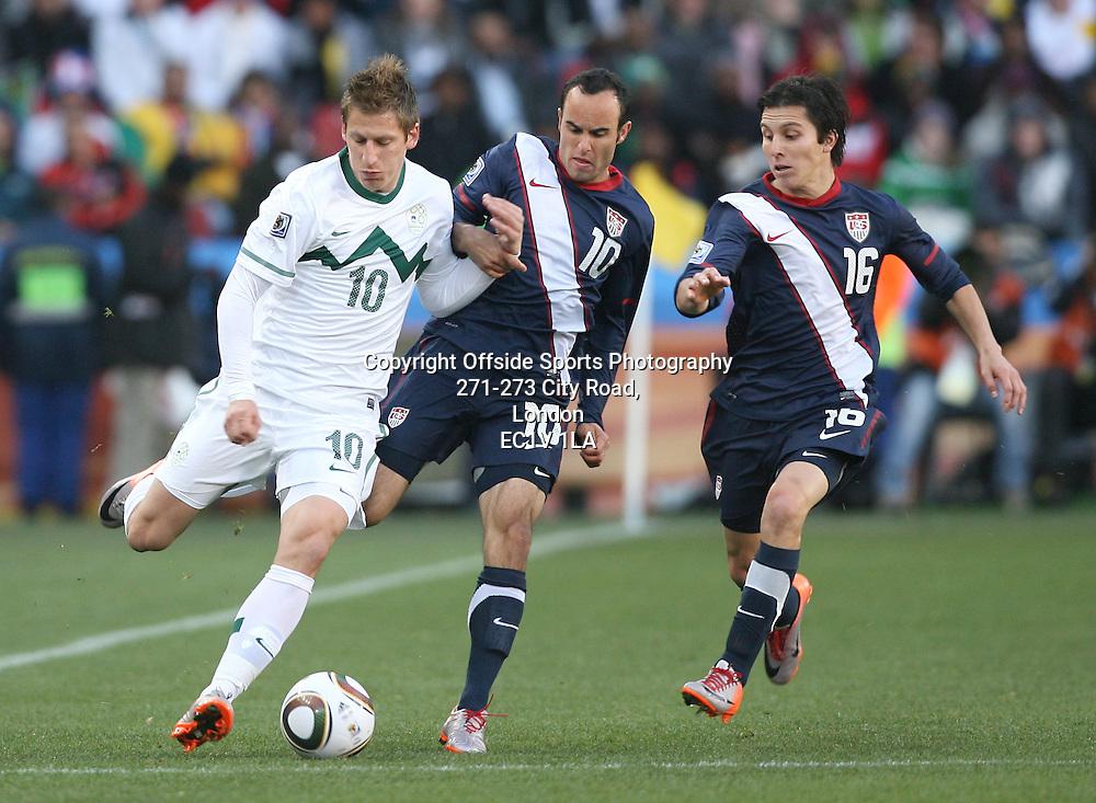 18/06/2010 - 2010 FIFA World Cup - Slovenia vs. USA - Valter Birsa of Slovenia battles with Landon Donovan (C) and Francisco Torres (R) of USA - Photo: Simon Stacpoole / Offside.