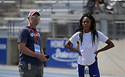 Jul 27, 2019; Des Moines, IA, USA; Erica Bougard (right) talks with coach Rris Mack during the USATF Championships at Drake Stadium.