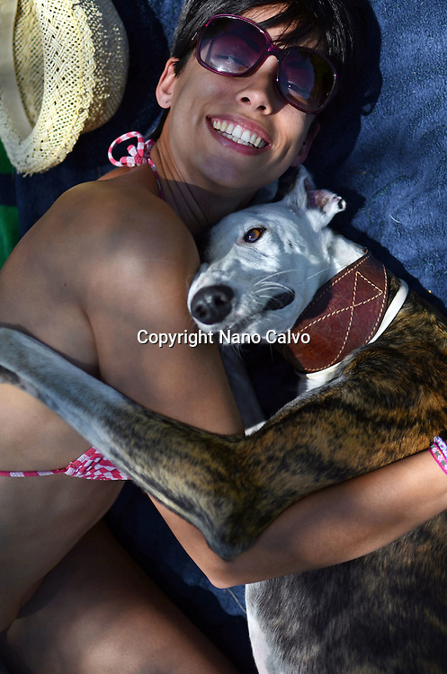 Young short haired woman hugging her Spanish Greyhound