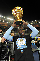 FOOTBALL - FRENCH LEAGUE CUP 2011/2012 - FINAL - OLYMPIQUE LYONNAIS v OLYMPIQUE MARSEILLE - 14/04/2012 - PHOTO JEAN MARIE HERVIO / REGAMEDIA / DPPI - CELEBRATION ALOU DIARRA (OM) AFTER THE VICTORY