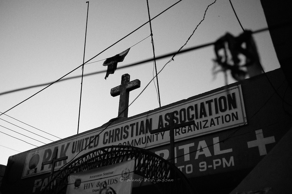 A cross on the roof of the Pakistan Christian society in the middle of the French colony slum.