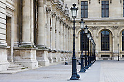 Row of street lights by Louvre Museum, Paris, France
