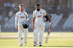 Essex batsmen Adam Wheater (left) and Ravi Bopara leave the pitch after hitting the winning runs against Lancashire, on day three of the Specsavers County Championship, Division One match at Emirates Old Trafford, Manchester.